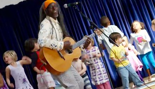 Asheba on stage with children
