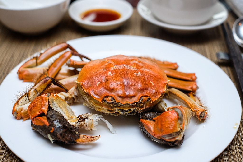 Szechuan Court & Kitchen: signature Steamed Whole Hairy Crab with Shiso Leaf on plate
