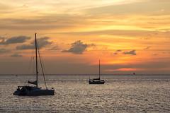 Sunset with yachts and catamarans at Nai Harn beach, Phuket, Thailand