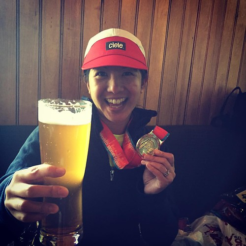 Mei with her beer and marathon medal.