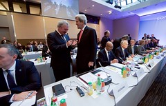 U.S. Secretary of State John Kerry speaks with Luxembourg Foreign Minister Jean Asselborn on January 15, 2017, at the Ministry of Foreign Affairs Conference Center in Paris, France, before the plenary session of a French-hosted conference on Middle East peace. [State Department photo/ Public Domain]