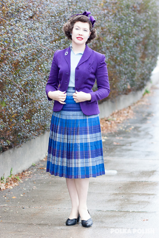 1940s vintage ensemble in blue and purple with a suit jacket and plaid Pendleton Turnabout skirt
