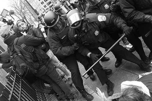 Riot police and protestors at Trump inauguration in Washington DC