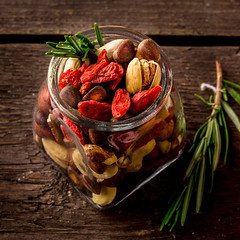 Different tipes of nuts in jar.