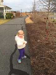 Madeleine plays outside yesterday