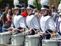 marching(0.0), festival(1.0), marching band(1.0), drummer(1.0), musician(1.0), parade(1.0), musical ensemble(1.0), drum(1.0), person(1.0), social group(1.0), skin-head percussion instrument(1.0),
