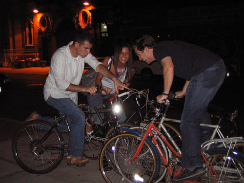 people riding chained up bicycles