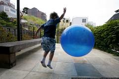 boy bouncing a big blue ball    MG 6996