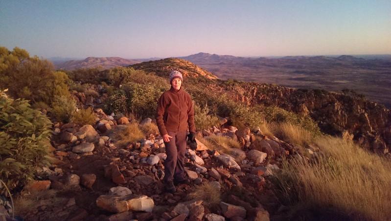 Margaret taking in the sunrise on Mount Sonder - Larapinta Trail