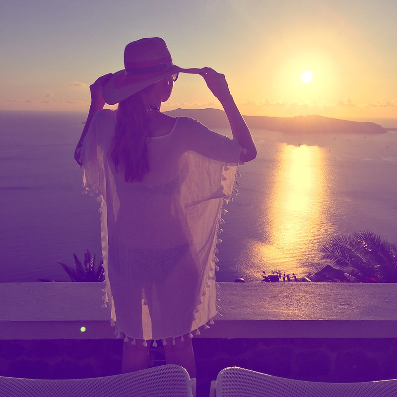Bikini, kaftan, wide-brimmed hat and sunset