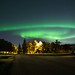 Urban Northern lights by midst of winter