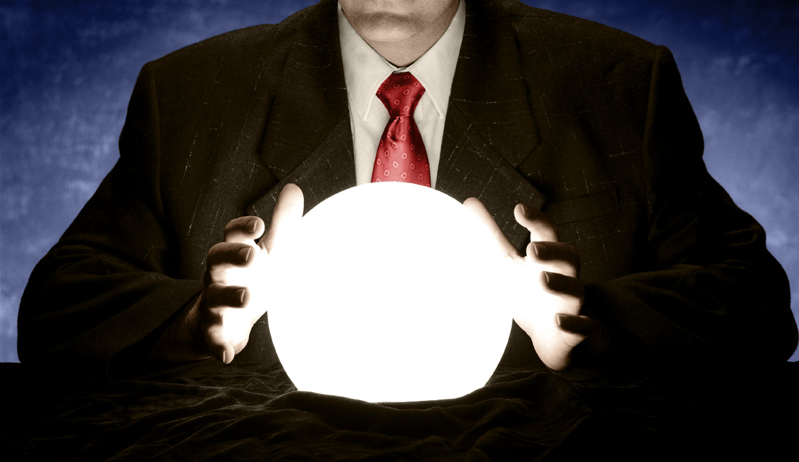 Businessman Consulting Glowing Crystal Ball