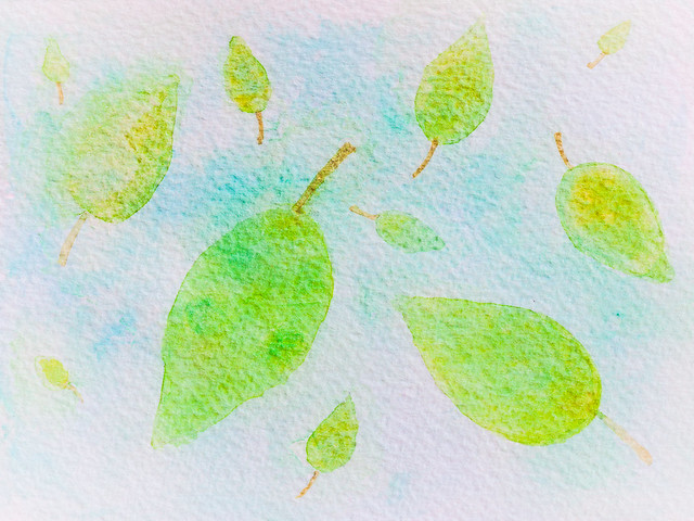 watercolor. green leaves on blue