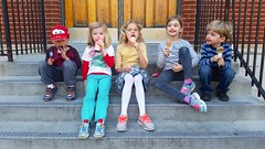 Kids Eating Ice Cream On The School Steps
