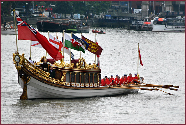 The royal barge Gloriana rowed down the River Thames as part of a flotilla to celebrate today's milestone.