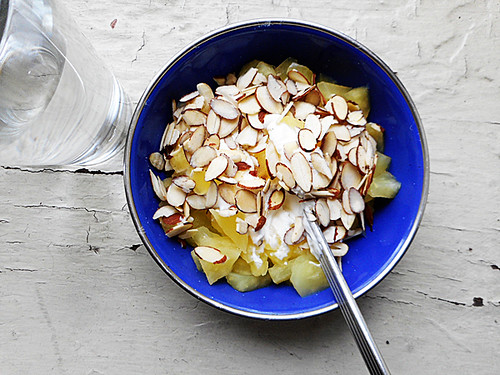 greek yogurt with microwaved apples and sliced almonds