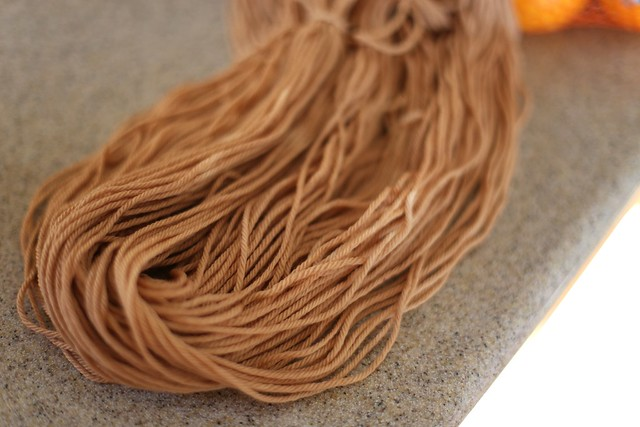 dock seed dyed yarn in the daylight