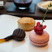 Candied orange peel dipped in chocolate, raspberry macaron, bonbon and scone