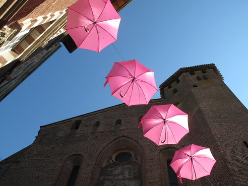 Pink umbrellas, red brick