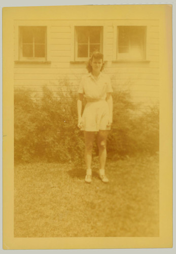 Woman at the side of t he house