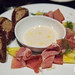 Pumpernickel pretzel rolls, Benton's ham, beer cheese fondue