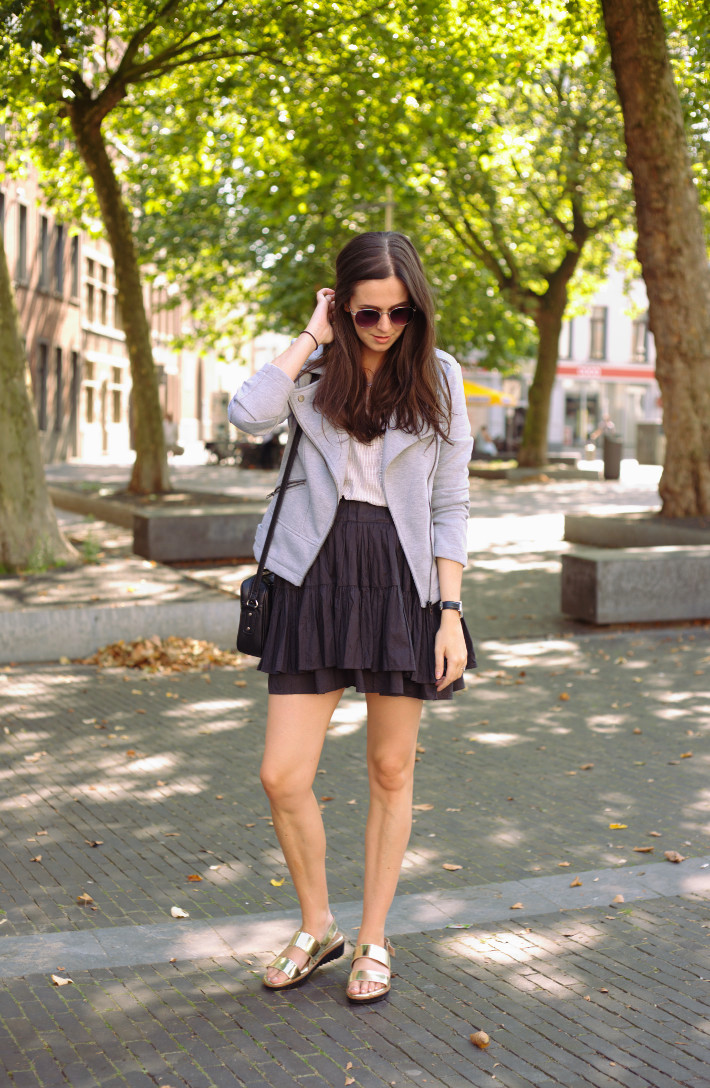 Outfit: transitional dressing in grey biker jacket, black skater skirt