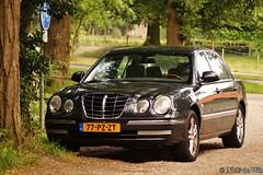 mercedes-benz e-class(0.0), automobile(1.0), executive car(1.0), wheel(1.0), vehicle(1.0), automotive design(1.0), kia opirus(1.0), full-size car(1.0), mid-size car(1.0), compact car(1.0), sedan(1.0), land vehicle(1.0), luxury vehicle(1.0),