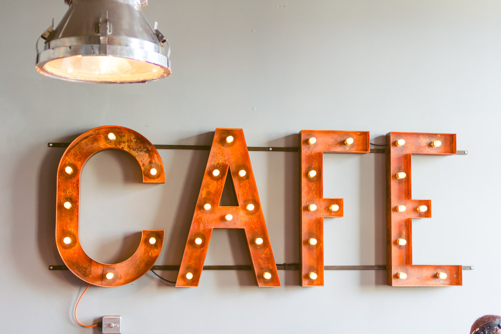 Artist residence hotel brighton colourful fun indie place to stay cafe sign
