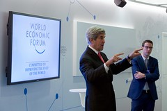 U.S. Secretary of State John Kerry, watched by World Economic Forum Young Global Leaders Director John Dutton, addresses a group of young business people on January 17, 2017, at the World Economic Forum in Davos, Switzerland. [State Department photo/ Public Domain]