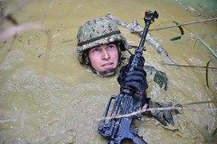 Seabee is participating in the endurance course at the Jungle Warfare Training Center in Okinawa, Japan.
