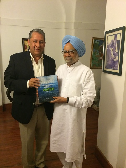Handing over the book to Former PM of India,Sri Manmohan Singh.JPG