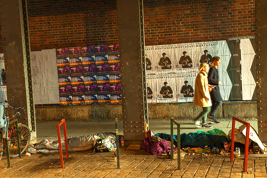 Two homeless people sleeping in underpass--Berlin
