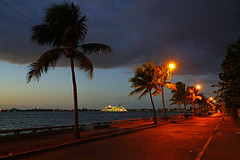 Cienfuegos at dusk. Palm trees & street lamps on the quay