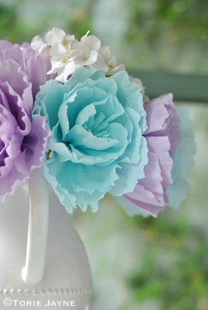 Crepe paper flowers in a jug