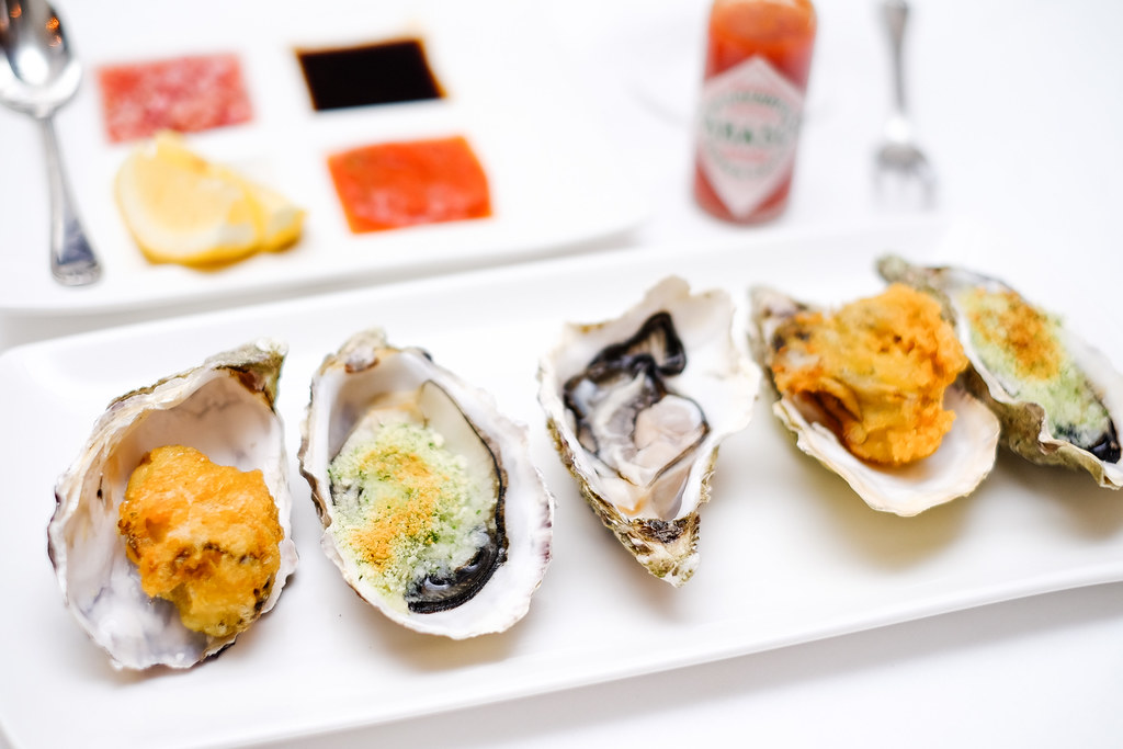 LaBrezza: oysters with condiments, crispy fried tempura, and gratin oysters with hrbs and breadcrumbs