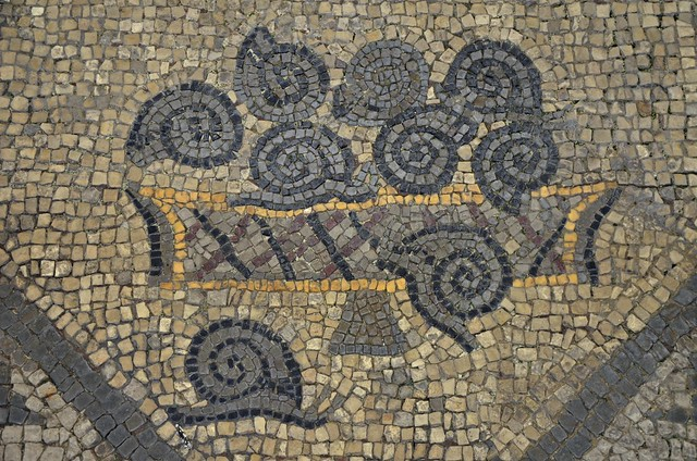 A detail from part of an early 4th century AD mosaic depicting a basket of snails belonging to the floor of the Theodorian transversal hall, Basilica di Santa Maria Assunta, Aquileia, Italy