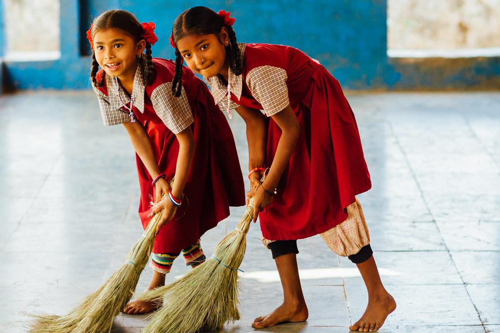 Two Girls Sweeping Floor, Schoolhouse in Purna Wildlife Sanctuary