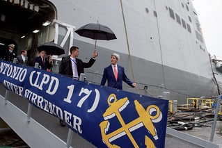 Secretary Kerry Walks Down a Plank as he Leaves the USS San Antonio
