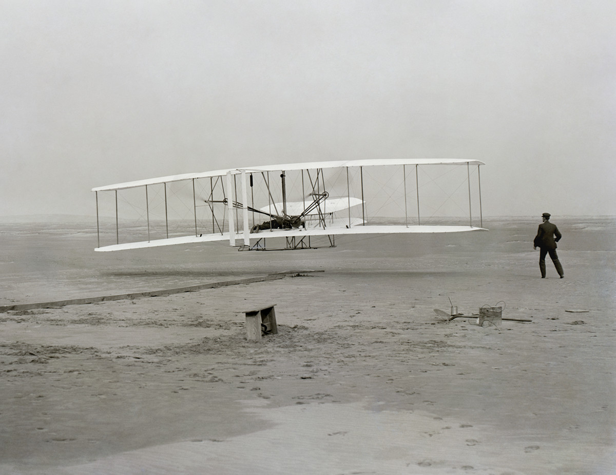 The Wright Flyer airborne during the first powered flight at Kitty Hawk, North Carolina