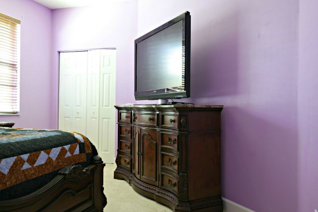 Bright Violet Walls in Guest Room