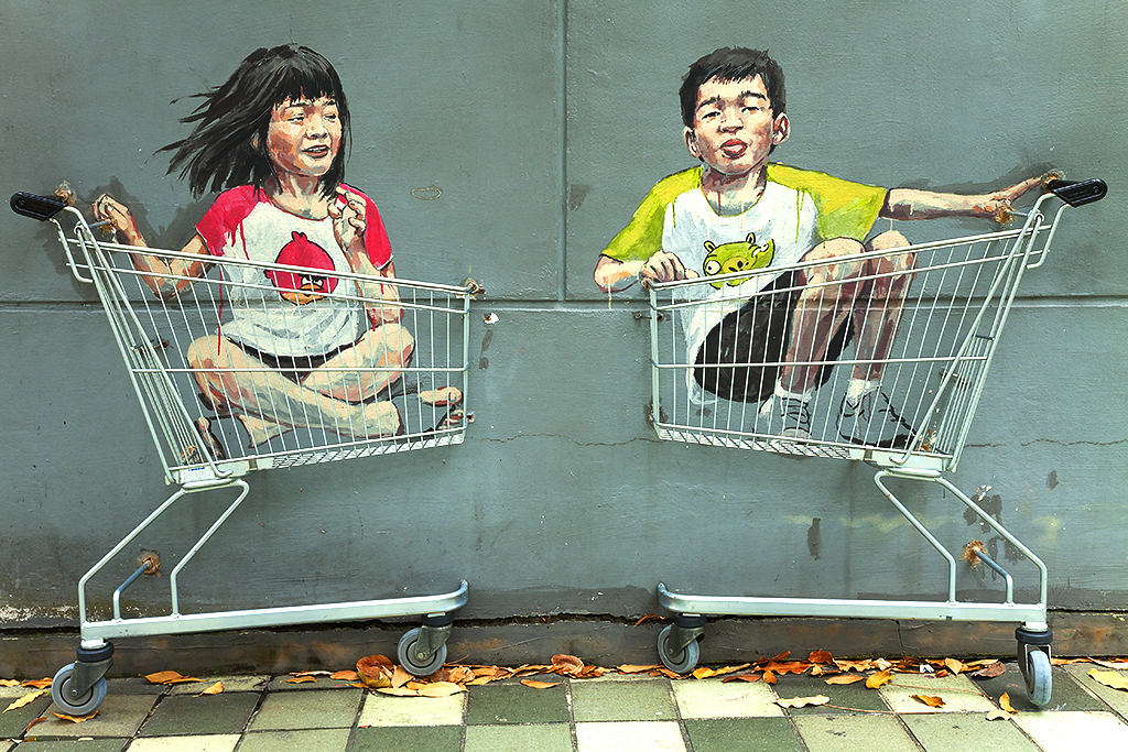Kids in shopping carts--Singapore