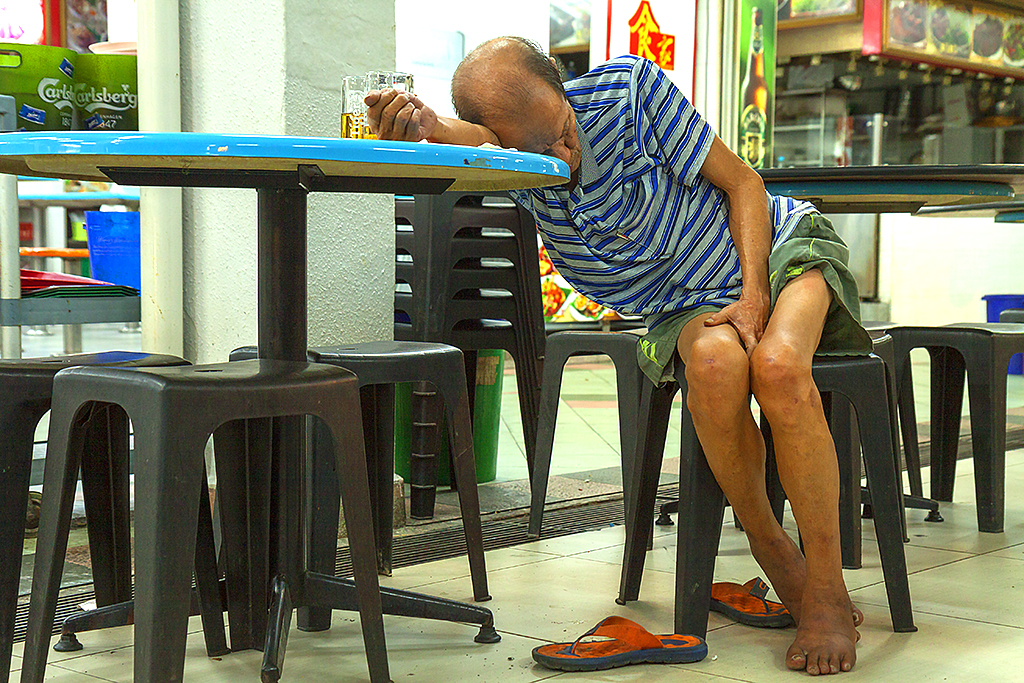 Old busboy sleeping--Singapore