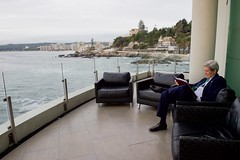 U.S. Secretary of State John Kerry takes break on a deck overlooking the Pacific Ocean as he reads briefing materials between sessions of the Our Ocean Conference 2015 in Valparaíso, Chile, on October 5, 2015. [State Department photo/ Public Domain]