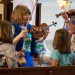 Wed, 05/06/2015 - 10:30 - Mrs. Thompson tuning violins