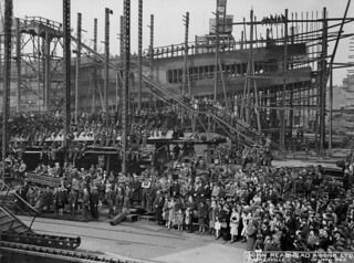 Spectators and workers at the launch of the cargo ship 'Baskerville'