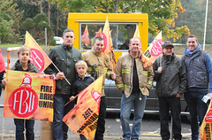 Norfolk firefighters with supporters outside the entrance to County Hall before the protest against cuts