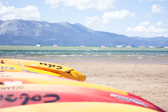 Empty South Tahoe Beach Kayaks on a Windy Day