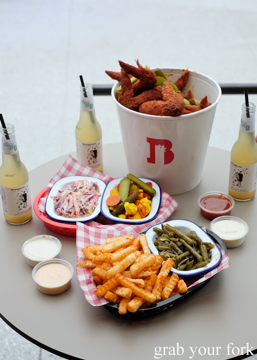 Baller Bucket of hot wings, Old Bay fries, coleslaw, Almost Arnold's Beans and pickles at Belles Hot Chicken at Wulugul Pop Up, Barangaroo