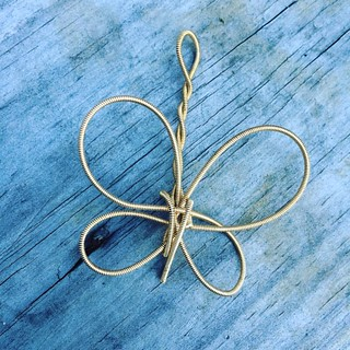 Broken #Autoharp string #3 of the day. On the bright side, I'm making some pretty pendants. #wireart #butterfly #pendant