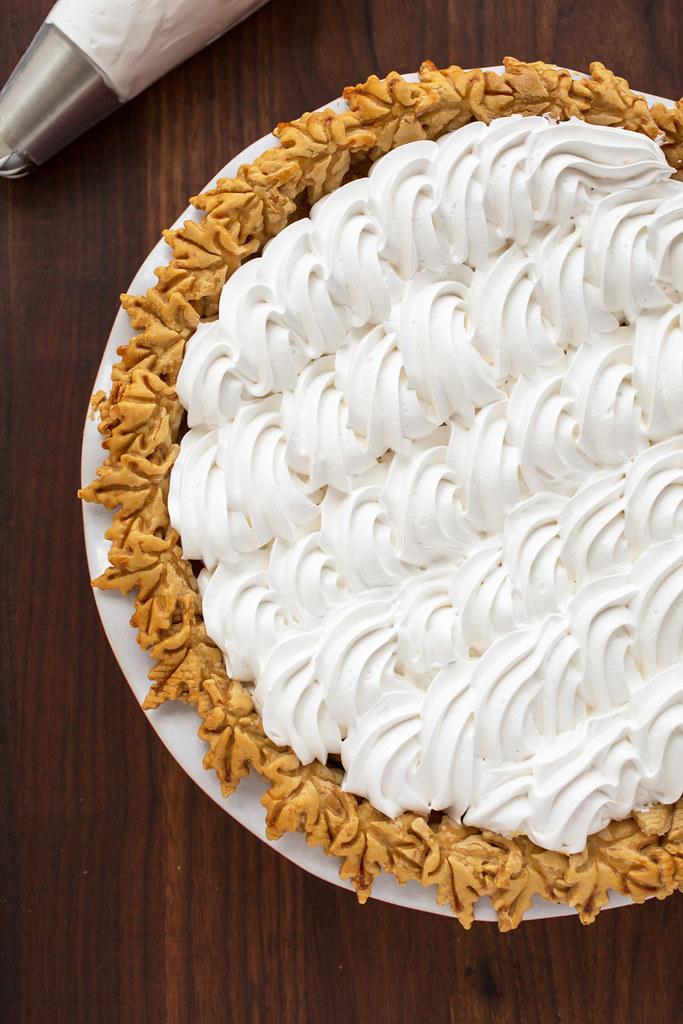 Piped marshmallow crème on sweet potato pie